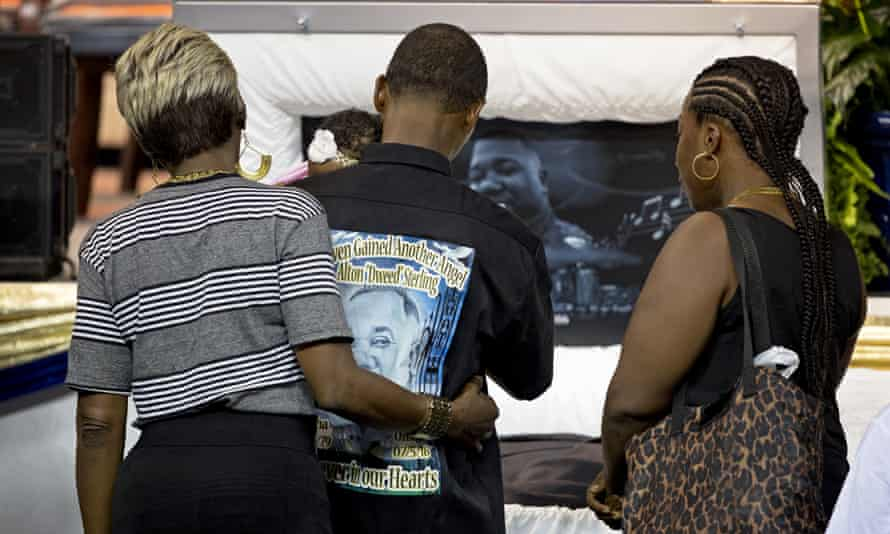 Mourners visit the body of Alton Sterling.
