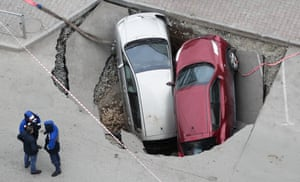 An aerial view of two cars swallowed by a sinkhole in Novosibirsk, Russia