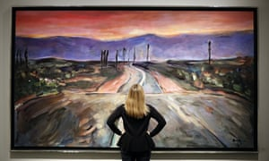 Middle of the road … A woman looks at Bob Dylan's Endless Highway before The Beaten Path exhibition opens