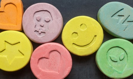 Ecstasy tablets on black background