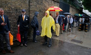 MCC members queue in the rain before the final at Lords.