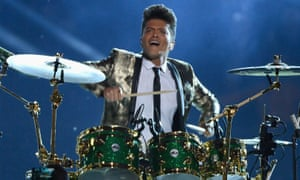 Bruno Mars gets his kit on at the 2013 Super Bowl halftime show.