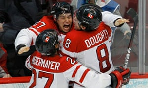 Canada celebrate winning ice hockey gold at the 2010 Winter Olympics