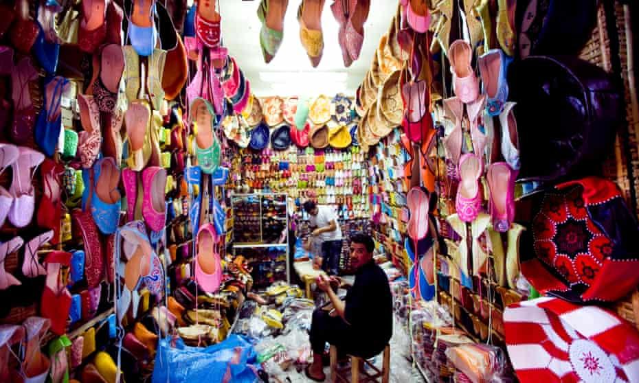 A shoe seller in the souk of Marrakech.