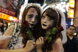 Participants in costume pose for a photograph during Halloween celebrations in Shibuya district, Tokyo, Japan.