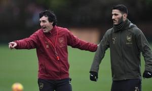 Unai Emery issues instructions to Sead Kolasinac during Arsenal training.