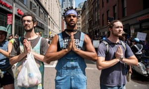 Three counter-protesters pretending to be praying.
