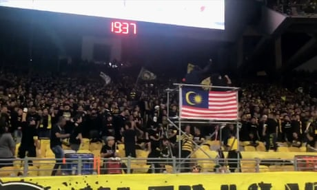 Malaysia fans perform collective chants before game with Indonesia – video