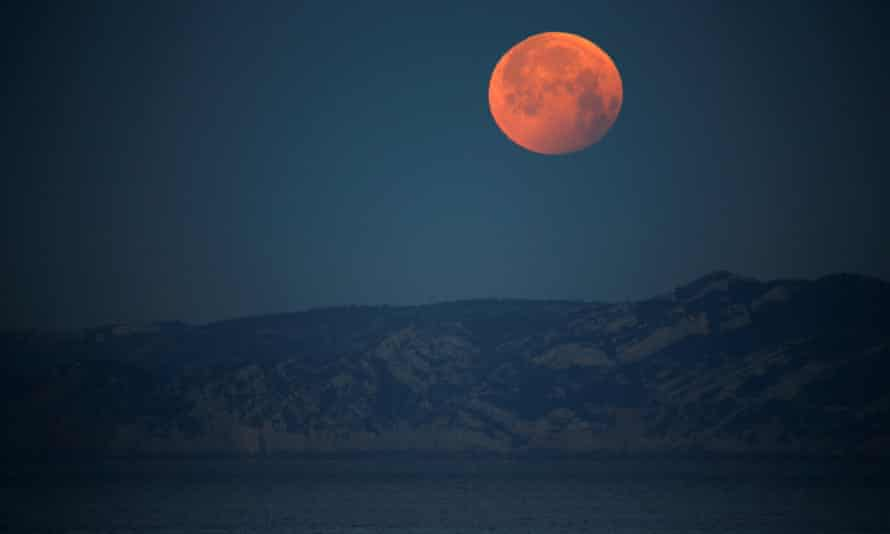 A 'super blood wolf moon' during a total lunar eclipse in Marseille, France, in January 2019. The May 2021 full supermoon will be seen on Wednesday from Australia to the US west coast.