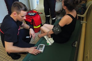 Tours, France A firefighter takes the blood pressure of a woman suffering from the heat