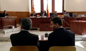 Lionel Messi (right) and his father Jorge Horacio Messi sit opposite judges in the Barcelona courthouse