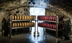 Recently finished wheels of cheese sit on carts in the cheese caves of the Sartori Cheese Company in Plymouth, Wisconsin.