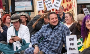 Comedian Mark Thomas protesting against PSPOs in Chester, in 2017.