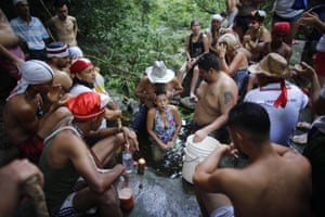 Juan Carlos Paso performs a cleansing ritual on a woman