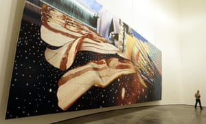 A photograph from 2004 shows a man walking past Star Thief by James Rosenquist, at the Guggenheim Bilbao Museum.