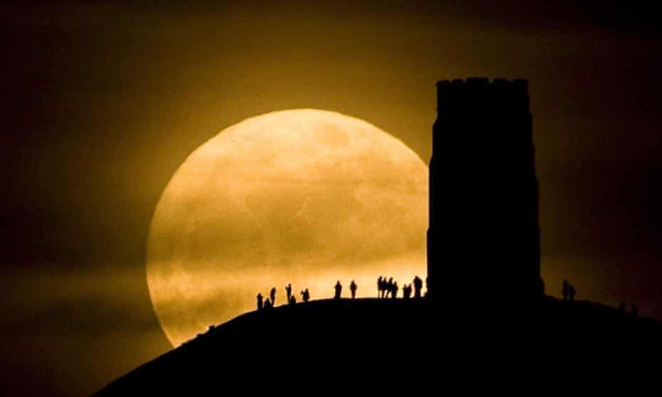 Watching the moon from St Michael's Tower on Glastonbury Tor.