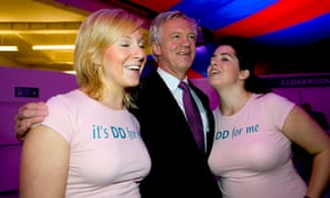 David Davis with women wearing DD for me promotional T shirts.