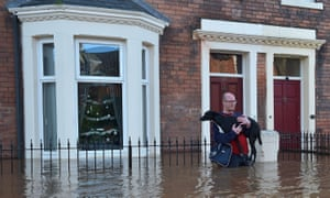Residents leave flooded homes