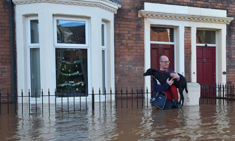 David Nicholson leaves his girlfriend's flooded home