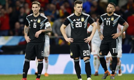 Lucas Biglia, Giovani Lo Celso, and Nicolas Otamendi look completely dejected after Spain notched their sixth.