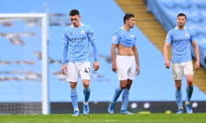 Manchester City's Phil Foden looks dejected after Chelsea's Marcos Alonso scores their second goal.