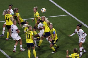 The United States and Sweden players  watch the ball.