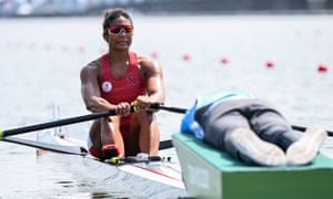 Trinidad and Tobago's Felice Chow competes in the women's single sculls rowing heats Friday in Tokyo. She did not qualify from this heat but worked her way into the next rounds in Saturday's repechage.