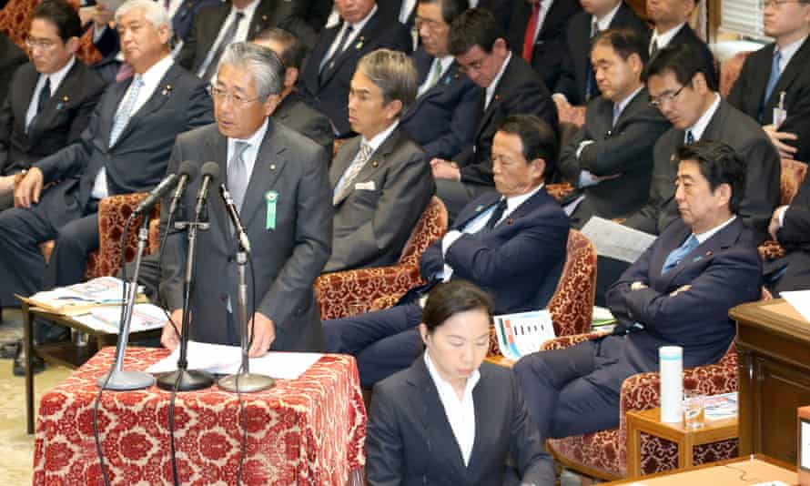 Tsunekazu Takeda, centre, speaks at the Japanese parliament after being summoned to answer questions regarding links between Tokyo's successful bid to host the 2020 Olympics and a Singapore bank account.