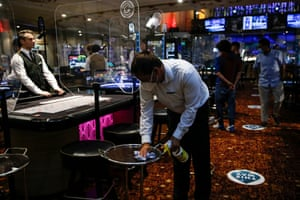 Casino staff clean surfaces at the Rialto casino on 15 August, 2020 in London, England. Enhanced safety and cleaning measures are put in place as Grosvenor Casinos prepare to reopen their entertainment venues for the first time since the coronavirus lockdown.
