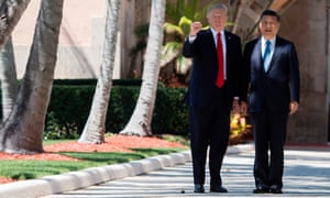 Trump and Chinese President Xi Jinping walk together at the Mar-a-Lago estate in West Palm Beach, Florida.