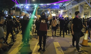 Protesters shine laser pointers at police
