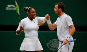 Serena Williams and Andy Murray celebrate during their mixed doubles match.