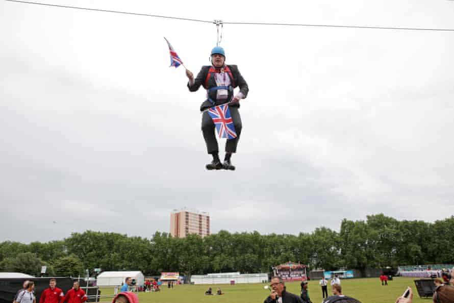 A flag-waving Boris Johnson gets stuck on a zip line during an Olympics event in London in 2012