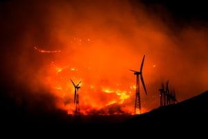 Wildfire passing by wind turbinesThe Mountain Fire of 2013. Located throughout parts of the San Jacinto Mountain near Palm Springs, Ca. I lived in Joshua Tree at the time and I could see the fire from my housePhotograph: Aaron Hawn/GuardianWitness