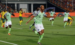 William Troost-Ekong celebrates his late winner for Nigeria, who will face Algeria or Ivory Coast in the semi-finals.