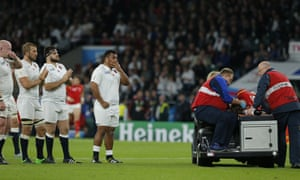 England players applaud as Scott Williams is stretchered off.