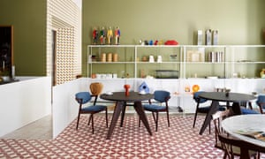 The kitchen-diner, with a mid-century table and Kai Kristiansen chairs.