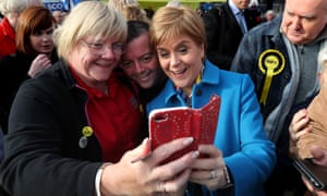 Nicola Sturgeon has a selfie taken with supporters on the election campaign trail in Alloa.
