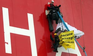 Naidoo gives a thumbs up as he climbs the Prirazlomnaya oil platform and holds a banner reading 'Don't kill the Arctic' in Russian, in the Pechora Sea, in 2012.