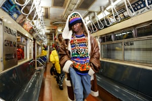 A Moschino 2020 collection by Jeremy Scott is modelled in a subway car at a museum in New York, US