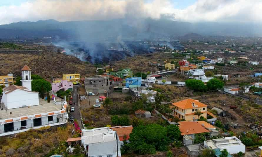 Smoke rises from lava on La Palma as residents are forced to evacute their homes.