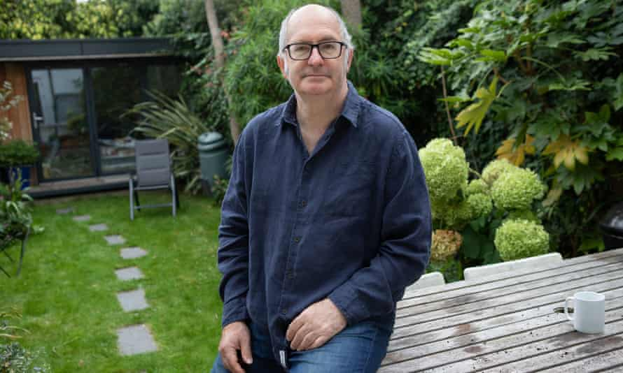 John Lanchester in front of his garden office where he writes, London, September 2020
