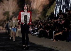 Lennon Gallagher models rock-star ready jackets on the Saint Laurent catwalk.