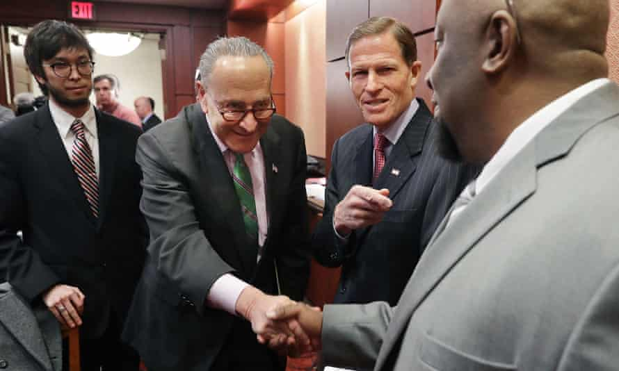 Senator Charles Schumer shakes hands with Alphonse Maddin, a truck driver against whom Neil Gorsuch issued a dissenting opinion.