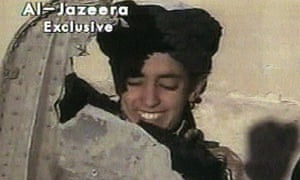 In this 2001 image made from video broadcast by al-Jazeera, a boy identified as Hamza bin Laden holds what the Taliban says is a piece of US helicopter wreckage in Ghazni, Afghanistan.