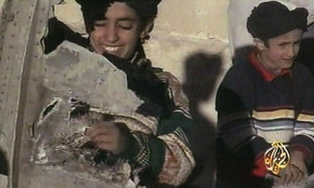 An image from 2001 video broadcast by Al-Jazeera showing a boy, identified as Hamza bin Laden, holding what the Taliban says is a piece of US helicopter wreckage in Ghazni, Afghanistan.