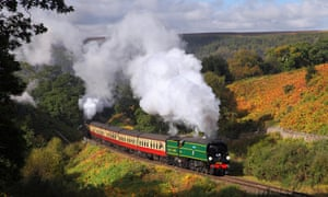 A steam train on the North York Moors Railway passes Thomason Foss.