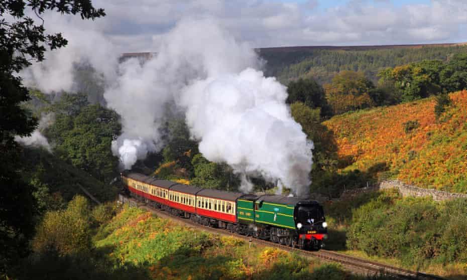 A steam train on the North York Moors Railway passes Thomason Foss.