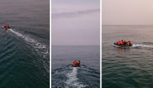 Migrants in a dinghy illegally cross the Channel