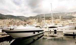 Luxury yachts moored in Monaco harbour.